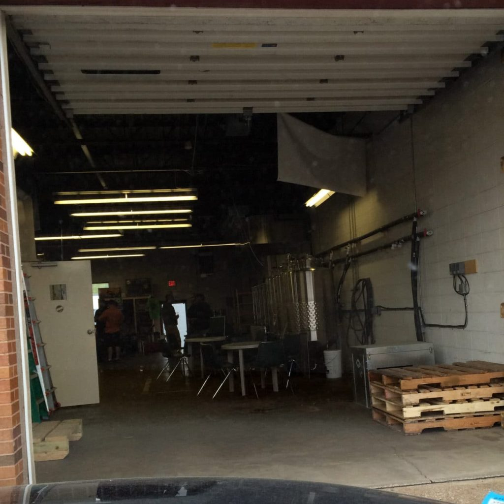 Erie Ale Works - A view from the outside looking in the garage door